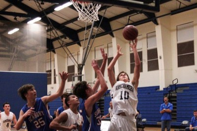 JV Boys Basketball shoots, scores over Spartans