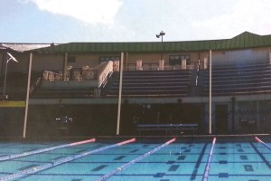 A structure will be built above the bleachers, providing shade for swimming and water polo fans and a base for the solar panels.